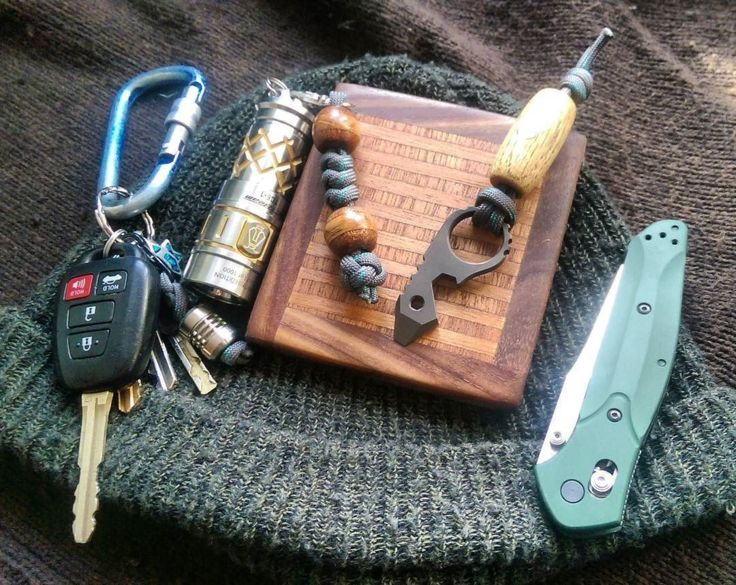 Benchmade - Preparing for a mid-March blizzard with some handmade beads, a coaster, oh... And a beanie of course. #EDC #pocketdump #knives #sunwayman #edcgear...
