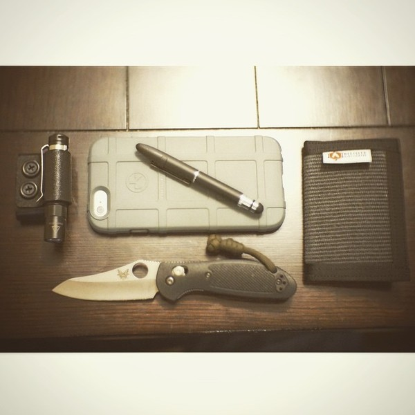 benchmade - This weeks carry #pocketdump #fisherspacepen #fenixlightld02 #fenixlight #benchmade #iphone6 #magpul #recycledfirefighter wallet